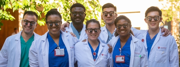 Interns wearing donated surgical loupes