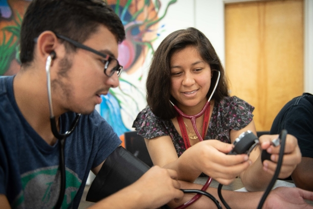 SMASH students learn to take blood pressure.