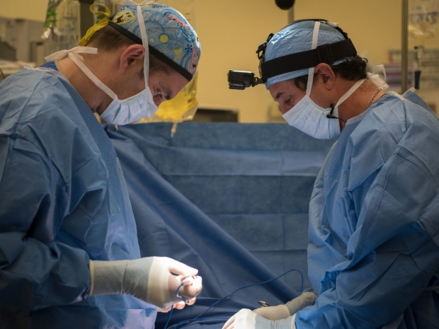 Pediatric Surgeon Dr. Bruzoni and Pediatric Surgery Fellow Dr. Enrico Danzer perform an operation